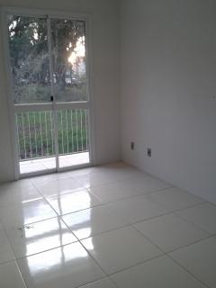 Apartamento composto de 02 Dormitórios, cozinha, sala com sacada, banheiro social e 01 box de garagem.