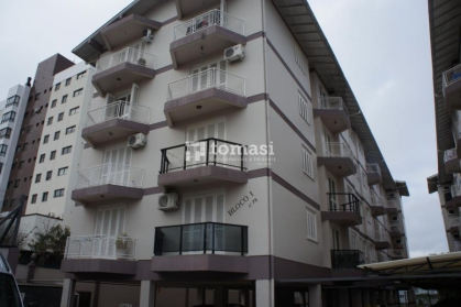 TOMASI Imóveis aluga, no bairro Cohab apartamento de 02 dormitórios e 1 box de garagem.
