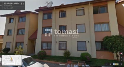 TOMASI Imóveis vende, apartamento térreo de 2 dormitórios e box de garagem.