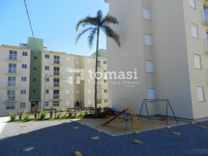 TOMASI Imóveis vende, apartamento de 2 dormitórios e box de garagem.